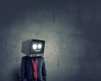 Man med TV i stället för huvudet Blandat massmedia royaltyfria foton