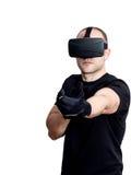 Man med virtuell verklighethörlurar med mikrofon som spelar videospel Royaltyfria Bilder