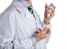Man in medical coat holding a 3d print lightbulb and a real one Stock Image