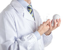 Man in medical coat holding a 3d print lightbulb and a real one Stock Photography