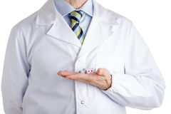 Man in medical coat holding dice Royalty Free Stock Photography