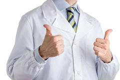 Man in medical coat making hitch-hiking with both hands. Man dressed with medical white coat, light blue shirt and glossy regimental tie with dark blue, light royalty free stock images