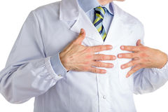 Man in medical coat pointing to his heart with both hands Stock Images
