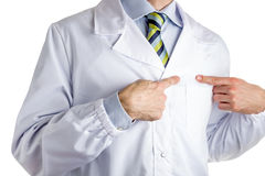 Man in medical coat pointing to his heart with forefingers Stock Photos