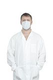 The man in a medical dressing. Gown and a medical mask. Isolated object Royalty Free Stock Photos