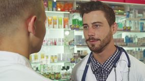 Doctor talking to patient at drugstore royalty free stock image