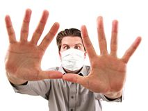 Man with Medical Mask. A man with medical mask close up isolated on white background royalty free stock photos