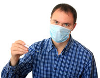 Man in a medical mask with a thermometer. Stock Photo