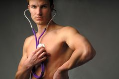 Man and  medical stethoscope Royalty Free Stock Photos