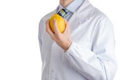 Man in medical white coat showing yellow lemon Royalty Free Stock Image