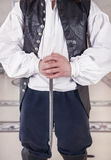 Man in medieval clothes holding dagger Stock Photography