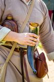 A man in medieval clothes holds a horn for wine royalty free stock photography