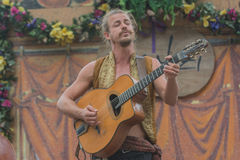 Man with medieval costume singing and playing guitar Royalty Free Stock Photo