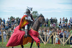 Man in a medieval historical clothes on horseback Stock Images