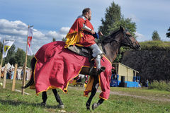 Man in a medieval historical clothes on horseback Stock Photo