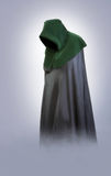 Man in an medieval hood and cloak in the fog royalty free stock photo
