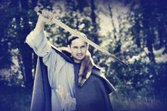 Man with medieval sword. Fantasy portrait of handsome dangerous man with medieval sword Stock Photos