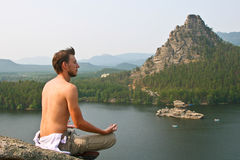 A man meditates during his yoga practice Stock Photos