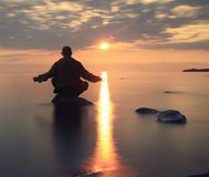 Man meditates on the lake Royalty Free Stock Photography