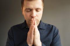 Man meditates or prays to God Stock Image