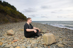 Man meditating Stock Images