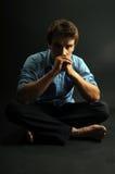 Man meditating Stock Images