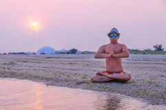 Man meditating on the beach Royalty Free Stock Photo