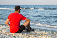 Man meditating on beach Royalty Free Stock Photo