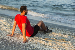 Man meditating on beach Royalty Free Stock Photos