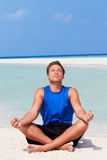 Man Meditating On Beautiful Beach Stock Image
