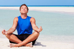 Man Meditating On Beautiful Beach Stock Photography