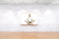 Man meditating on built-in-wall seating Royalty Free Stock Images