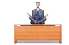 Man meditating on the desk Stock Photos