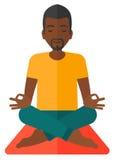 Man meditating in lotus pose Stock Images