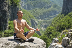 Man meditating in lotus position Royalty Free Stock Photos