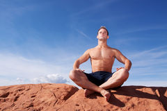Man meditating outdoors Stock Photography
