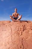 Man meditating outdoors Stock Image