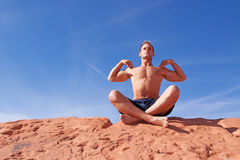 Man meditating outdoors Stock Photo