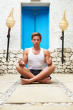 Man Meditating Outdoors At Health Spa Stock Photography