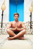 Man Meditating Outdoors At Health Spa Stock Photos