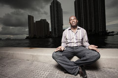 Man meditating outdoors at night Stock Photos
