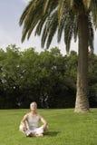 Man Meditating In Park Stock Photography