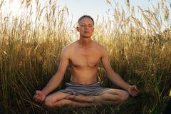 Man meditating Stock Photography