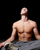 Man meditating in teh dark Royalty Free Stock Images