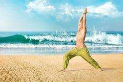 Man meditating in warrior pose Stock Photos