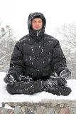 Man meditating in winter Stock Photo