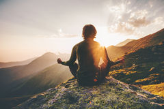 Man meditating yoga at sunset mountains. Travel Lifestyle relaxation emotional concept adventure summer vacations outdoor harmony with nature Royalty Free Stock Photos