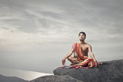 Man meditating Stock Image