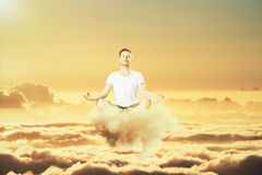Man meditation in the clouds concept Stock Photos