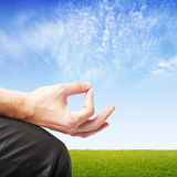 Man in meditation. On green field  background Stock Photography